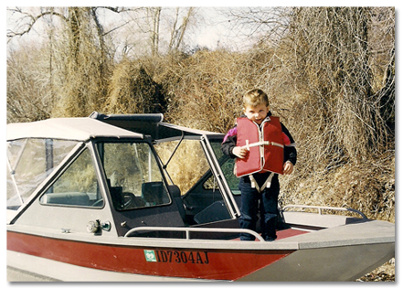 Photo of Brock on Grandpa Scott's boat
